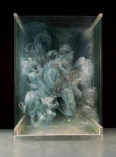Xia Xiaowan~done on panels of glass that are stacked together.