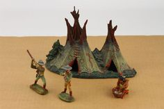 This set is c.1930s, when Elastolin produced various composite sets related to Cowboys & Indians. Included are the Double Tepee, a sitting Indian, a cowboy aiming a rifle, and a cowboy swinging his rifle.   eBay!