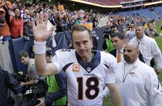 Peyton Manning breaks the NFL record by throwing his 51st touchdown pass in one season against the Houston Texans on December 22, 2013.