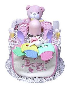 This colorful and fun girl-themed Diaper Cake is sure to charm the lucky gift recipient. Present one as a baby shower gift, or use it as a creative shower centerpiece. Every item in the Diaper Cake is