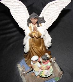 African American Angel Figurine on Bridge with Children