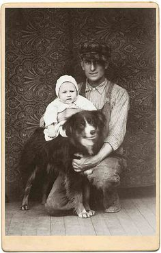 Vintage photo, child, dog and man wearing cap and overalls.