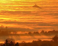 Glastonbury Tor, UK, rising above the fog in the early morning.