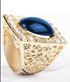 The Moody Blue cabochon is an exqusite example of the fine quality Jewelry Elvis wore onstage. he loved colored stones to match his jumpsuits. This beautifuly styled  Nugget Design was a favorite and he actually had several pieces done with differant colored stones matching his stage decor. Ring  is made of 14 kt gold and rhodium .