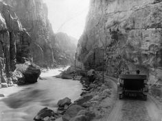 vintage photos idaho | Photo: A car driving beside a river in a canyon