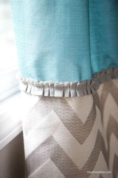 DIY curtains. I like the idea of putting the ruffled part on the curtains.- ruffle on curtain