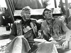 RED RIVER (1948) - John Wayne & Montgomery Clift are tired & bewildered - Produced & Directed by Howard Hawks - United Artists - Publicity Still.