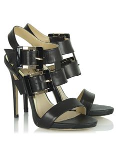 These strappy stiletto sandals from Daniel Footwear in black have wide dual straps to the ankle with chunky gold and buckles as well as a single toe strap and stiletto heels that measure approximately inches Black Wedge Sandals, Black Shoes, Designer High Heels, Stiletto Heels, Footwear, Wedges, Lady, Boots, Women