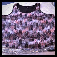 """PLUS SIZE TORRID TOP TORRID CHEVERON OVERLAY ON SEQUINED BOTTOM. RACER BACK WITH SCOOP NECK. LENGHT IS 30"""". GREYS, BLACK, AND PEACH AND OF COURSE SEQUINS. GORGEOUS TOP ! ALMOST NEW. TORRID Tops"""