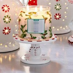 """Mr. Frosty Pedestal Jar Holder This frosty fellow is all smiles when holding a jar candle, sold separately. Ceramic. 2¾""""h 7 cm h, 5¼""""w 13 cm w. $25.00 each http://www.partylite.biz/legacy/sites/juliehoyman/productcatalog?page=productdetail&name=Mr.+Frosty+Pedestal+Jar+Holder&sku=P92522&categoryId=57722&showCrumbs=true"""