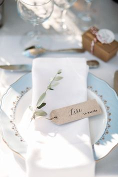Simple place card tags, delicate white and blue china. A collection of the dreamiest and most unique winter wedding ideas you can steal for those planning to tie the knot during the colder season, Wedding Place Settings, Wedding Place Cards, Wedding Menu, Wedding Ideas, Vintage Winter Weddings, Provence Wedding, Greek Wedding, Wedding Table Decorations, Wedding Places