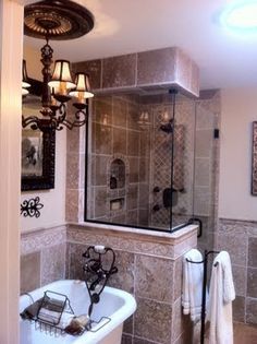 The Tile Shop: love the inset box in this travertine bathroom