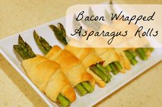 We are a bacon loving family! Who isn't? And with the holidays coming up, we'll be thinking of lots of appetizers to serve guests. So why not combine a few favorites with this awesome bacon wrapped asparagus roll? It's simple, only 4 ingredients, and easy to make! Plus the combination of the cream cheese and bacon inside with the asparagus is to die for. And how can you go wrong with buttery crescent rolls! Bacon Wrapped Asparagus Rolls Ingredients 1 can crescent rolls 1 pound asp...
