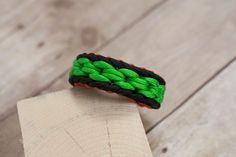 Chainlink Paracord bracelet with green black and orange