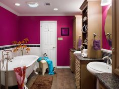 Tween girls will swoon over this glamorous adult-like bathroom with its regal clawfoot bathtub and over-the-top color palette. To tame the bold fuchsia walls, designer Cindy Aplanalp added white subway tiles to the wall and incorporated light wood cabinetry and storage shelves.