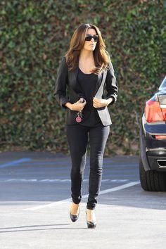 3. Eva wearing all black like a professional. We love the coat!