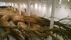 Artist Henrique Oliveira Constructs a Cavernous Network of Repurposed Wood Tunnels
