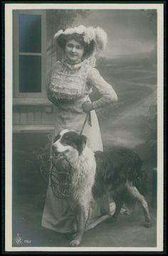 Lady carry Collie dog on back original old c1910