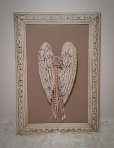 Shabby angel wings french cottage inspired embellished antique frame vintage white hand painted by Julie Roberts. Check out www.elevateddecorco.com for more details and other one-of-a-kind home decor!