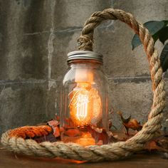 Brilliant idea using #rope, a #jamjar and a light bulb! #beautiful #falldecor #homedecor #DIY