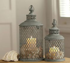 Shabby chic decoration ideas - candles, lanterns and shells VintageStyleLiving.com