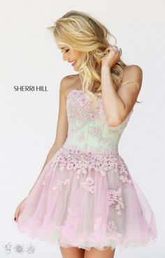 Sherri Hill 11062 is so dainty and girly! With a tightly git bodice full of floral inspired beading and a layered skirt, this dress is full of fun! In so many different colors, this dress has options for everyone and can be worn to so many events! Pair with fun heels and rock a night on the town!