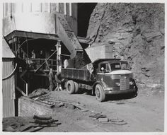 Asbestos ore from storage bin passing down shute onto the back of Commer truck, Wittenoom asbestos mine, July Wa Gov, Growing Up, Transportation, Death, Trucks, Australia, Cars, Grow Taller, Truck