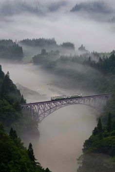 The first train goes across the railway bridge in the morning mist, Mishima town in Fukushima prefecture, Japan (photo by Teruo Araya for National Geographic Traveler Photo Contest) Fukushima, Photographie National Geographic, National Geographic Photography, Trains, Landscape Photography, Nature Photography, Photography Photos, National Geographic Photo Contest, Santa Fe