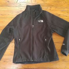 Woman's North Face Jacket Black fleece Authentic North Face! It has to pockets and drawstrings to tighten the waist. It is in great gently used condition! There is a tiny bit of wear on the right sleeve but it's not noticeable when worn! All zippers lay flat and work perfect! The North Face Jackets & Coats