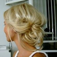 Cute messy updo.