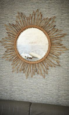 A new take on a classic -- bamboo and rush starburst mirror.