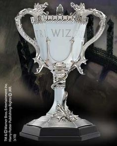 The TRIWIZARD Cup A recreation of the Triwizard cup from Harry Potter and the Goblet of Fire. Made of die cast metal and fine pewter. Comes with wooden display base. Measures approximately 8 inches in height.