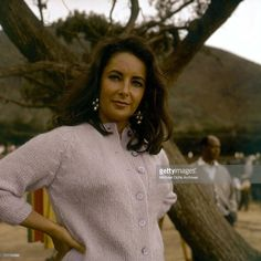Actress Elizabeth Taylor posing on the set of the film, 'The Sandpiper,' c. 1965.