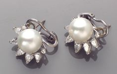 A pair of South Sea cultured pearl, diamond and platinum earrings