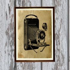 Vintage camera print on handmade antique paper.    Beautiful 8.3 x 11.7 (A4) antiqued decor for your home and office.    The paper was antiqued by hand