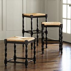 Each turned spindle leg farm stool is crafted in Italy of solid beechwood with hand woven rush seat. Seating features vase-and-ring turnings and nicely shaped cross-stretchers.