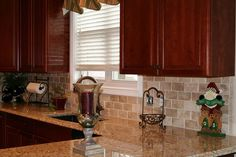 Venetian Gold quartz counters with cherry cabinets and tiled backsplash
