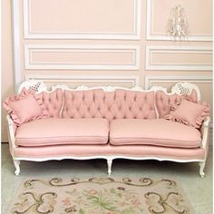 Pink Colonial French Sofa, pink can be a grown up color too! Lovely tufted back against the wainscoting makes for a mature space.