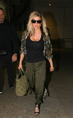 Fergie makes camp chic in her incognito-inspired ensemble complete with classic wayfarer #shades.