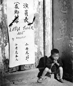 "Kunming, Yunnan, Republic of China. 30 November 1944. Portrait of ""Little Tiger Joe"", a three-year-old Chinese orphan informally adopted by the U.S. 907th Engineers Headquarters Company, Fourteenth Air Force (""The Flying Tigers""), United States Army Air Forces, in Kunming."