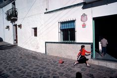 David Alan Harvey. SPAIN. Andalusia. 1977. Girl in red shirt with balloon.