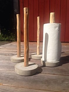 Paper towel holder made of concrete and juniper wood, made by myself.