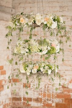 Whimsical hanging floral arrangements consisted of blush, ivory, and green blooms - unique wedding flower decor idea  {Ashley Marks Photography}