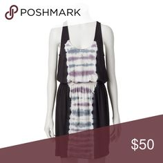 Rock & Republic® Racerback Tie-Dyed Blouson Dress Product Details Rock the look. This women's Rock & Republic dress gives you edgy style.  PRODUCT FEATURES Tie-dye center panel adds a retro look Racerback Scoopneck Sleeveless FIT & SIZING 37-in. approximate length from shoulder to hem Blouson styling Elastic waistband FABRIC & CARE Viscose, spandex Machine wash - delicate Imported Dresses
