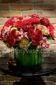 Red roses, colored hydrangea, red peonies with decorative zebra leaf.