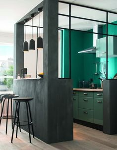 semi-opened kitchen, distingueshed by colour
