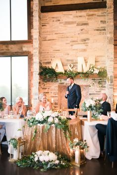 Fireplace and sweetheart table decor for blush & white spring wedding at Stone Crest Venue.