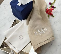This Flax color looks like it might be good color to contrast with the blue wallcovering. Might need to buy and review. Hard to be sure from website !  Do you ever do monograming !?   Linen Hemstitch Guest Towels, Set of 2 | Pottery Barn