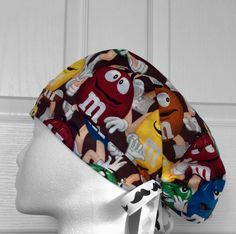 Candy cotton tie back scrub hat with adjustable front band, elastic backing, and ribbon ties. Yum!