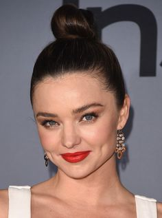 Top Knot Updo - Miranda Kerr did her best Nutcracker ballerina impression in a fun top knot and red lip.